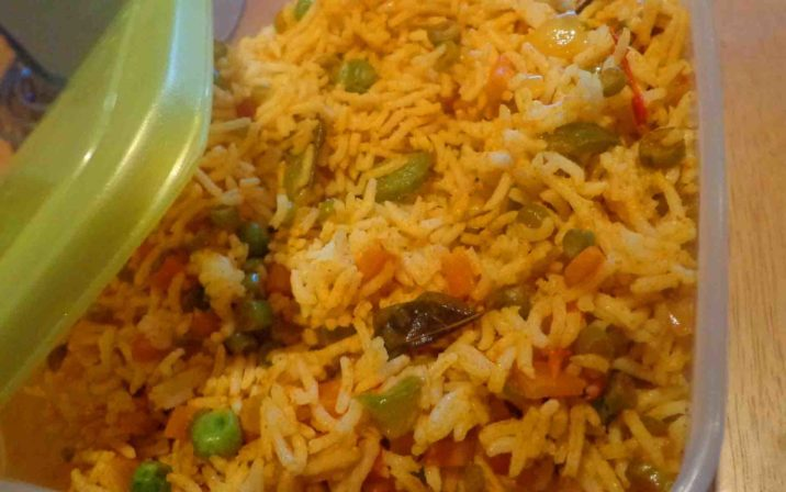 Sambhar Fried Rice In A Box With Open Green Lid On Table