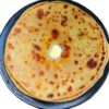 Instant Aloo Ka Pratha In A Pan On Plain White Background