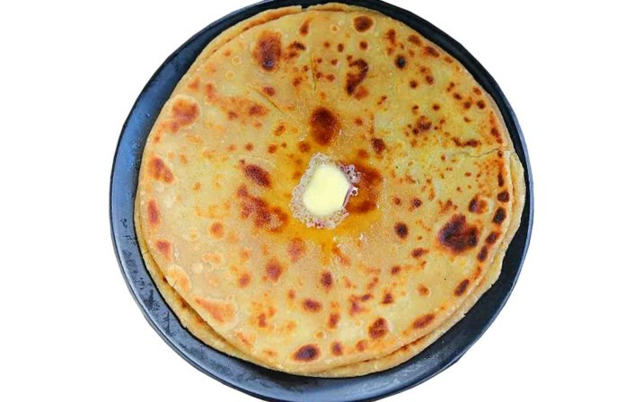 Instant Aloo Ka Pratha In A Pan On Plain White Background