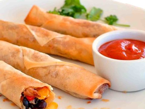 Instant & Delicious Chicken Spring Rolls In A Plate With Ketchup And Mint Leaves