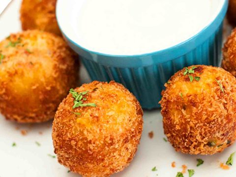 Potato Bombs In A Plate With A Sauce In The Center